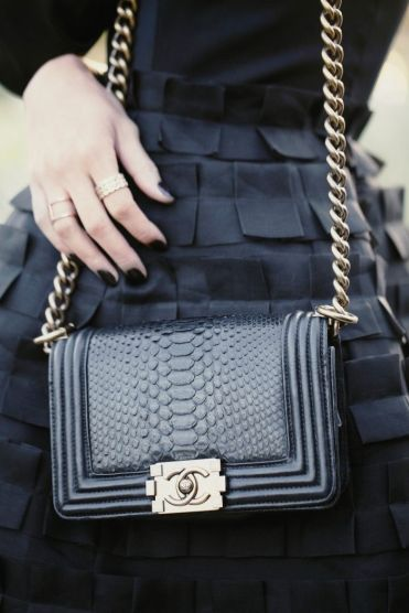All black Chanel Boy