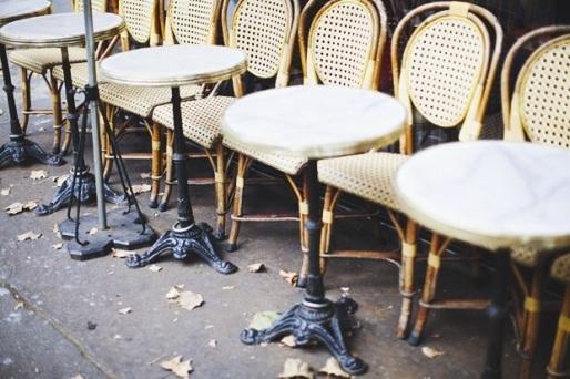 Autumn leaves at the terrace of a Parisian café