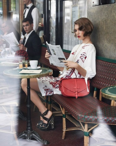 Louis Vuitton ad at a Parisian Café