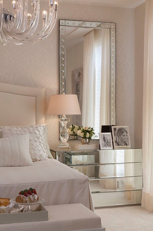 Mirrored nightstand in neutral bedroom