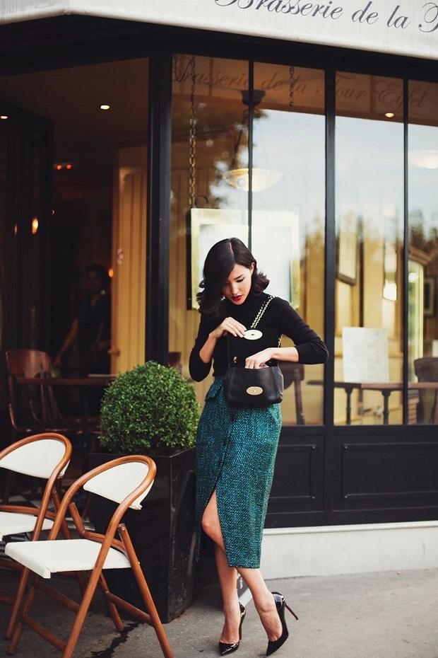 Nicole Warne Turtleneck and green skirt and louboutin